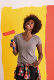 Black woman painting wall Royalty Free Stock Photography