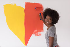 Black woman painting wall stock image