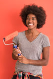 Black woman painting wall Stock Photography