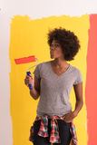 Black woman painting wall Stock Image