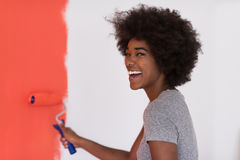 Black woman painting wall Stock Photos