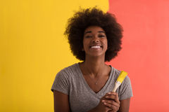 Black woman painting wall Royalty Free Stock Photos