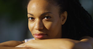Black woman in a park looking at camera royalty free stock photos