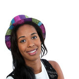 Black woman in a party hat. A young African American woman wearing a colorful party hat Royalty Free Stock Images