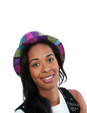 Black woman in a party hat. A young African American woman wearing a colorful party hat Stock Photos