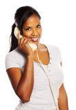 Black woman on the phone. Portrait of a isolated young pretty black woman on the phone Royalty Free Stock Photo
