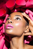 Black woman in pink creative hat. Royalty Free Stock Photo