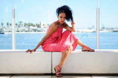 Black woman with pink dress and earrings. Afro hairstyle Royalty Free Stock Images