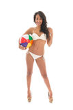 Black woman playing with beach ball Royalty Free Stock Photos