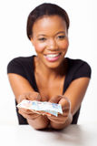 Black woman presenting money Stock Photo