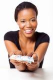 Black woman presenting money Stock Photo