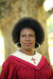 Black woman in red church robes outdoors portrait Stock Photography