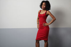 Black woman in red evening slim dress Royalty Free Stock Image