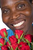Black woman with red roses Stock Photography