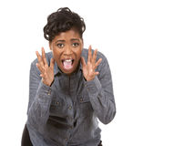 Black woman screaming. Pretty black woman wearing casual outfit on white background Stock Photos