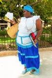Black woman selling roasted peanuts in Havana Stock Images
