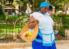 Black woman selling roasted peanuts in Havana Stock Photos