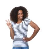 Black woman showing two fingers peace sign Stock Photo