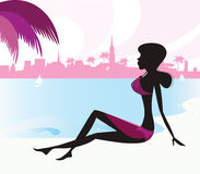 Black woman silhouette relaxing on tropical beach Stock Images