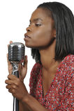 Black Woman Singer. Beautiful woman singer performing at a concert royalty free stock images