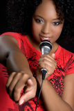 Black Woman Singing. Beautiful black woman singing karaoke stock image