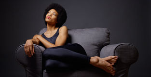 Black woman sitting in armchair Stock Photography