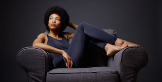 Black woman sitting in chair thinking Stock Images