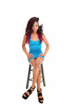 Black woman sitting on chair. Stock Images