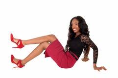 Black woman sitting on floor. Royalty Free Stock Image