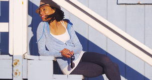 Black woman sitting outdoors on stairs Royalty Free Stock Photo