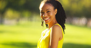 Black woman smiling in a field Stock Image