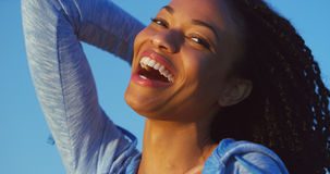 Black woman smiling and laughing Royalty Free Stock Images