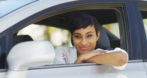 Black woman smiling and looking out of car window Stock Photos
