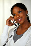 Black woman smiling and speaking on phone Royalty Free Stock Images