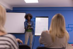 Black woman Speaker Seminar Corporate Business Meeting Concept. Young african american Speaker Seminar Corporate Business Meeting Concept Royalty Free Stock Image