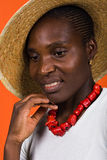 Black woman with straw hat Stock Photography