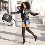 Black woman in the street with a briefcase Royalty Free Stock Images
