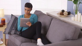 Black woman surfing the net on tablet Stock Photos