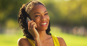 Black woman talking on phone outdoors Stock Photos