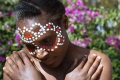 Black woman in tribal paint Royalty Free Stock Images
