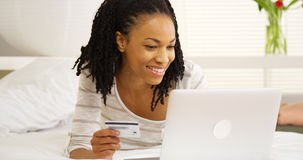 Black woman typing in credit card number Royalty Free Stock Photography