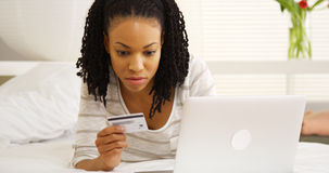 Black woman typing in credit card number Royalty Free Stock Images
