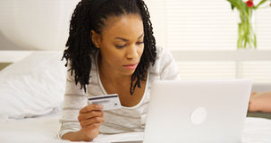 Black woman typing in credit card number Stock Image