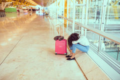 Black Woman upset and frustrated at the airport with flight canceled. Woman sad and unhappy at the airport with flight canceled royalty free stock photo