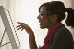 Black woman using computer stock photos