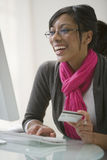 Black woman using credit card for e-commerce Stock Photography