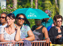 Black Woman Using Umbrella As Sunshield. Los Angeles, USA - October 17,2011: Women of all classes without medical insurance wait in line on a hot, sunny day to Stock Image