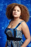 Black woman wearing blue and black dress Stock Images