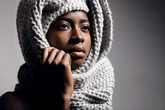 Black woman wearing knitted scarf Royalty Free Stock Image