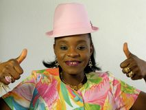 Black woman wearing a pink hat thumbs up Royalty Free Stock Photo